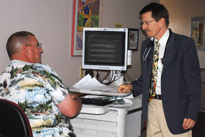 Dr. Sargeant, Hospitalist, speaks with a Gila Regional Nurse