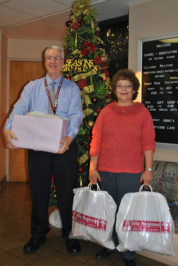 CEO Brian Cunningham presents El Refugio Silvia Madrid with toiletries donated by GRMC Caregivers.